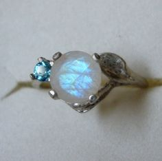 Hey, I found this really awesome Etsy listing at https://www.etsy.com/listing/250688987/rainbow-moonstone-ring-london-blue-topaz