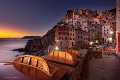 Photograph Le Cinque Terre, small boats take the last sun by Roberto Nencini on 500px