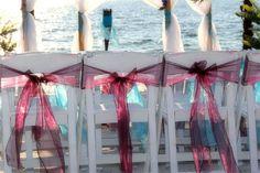Eggplant and blue sashes at a glorious Florida Beach Wedding