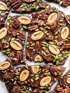 This pumpkin buttercrunch is spiced to perfection and covered with a layer of milk chocolate, roasted pepitas and toasted pecans. Delicious! Homemade Candies, Homemade Desserts, Desserts To Make, Healthy Dessert Recipes, Pumpkin Cookies, Pumpkin Dessert, Pumpkin Recipes, Fall Recipes, Thanksgiving Recipes