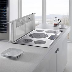 Thermador cooktop with pop up vent, something like we might do on island