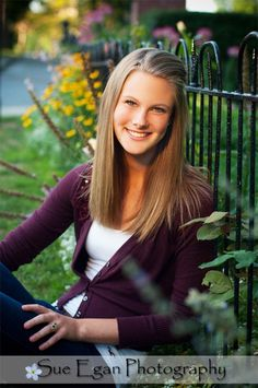 Fun, fresh, cityscape, on location Rochester, NY High School Senior photography  blonde female teen, iron fence, wild flowers, golden glow, historic neighborhood http://www.seganphoto.com/portfolio_seniors.html