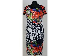 Navy, white and orange dress with a beautiful floral print. Available on our website www.midletonwood.co.uk in sizes 10-16