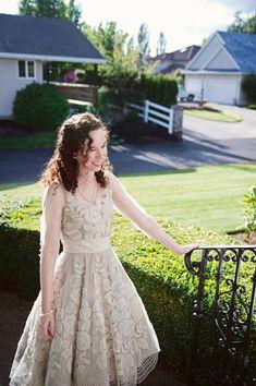 bride in BHLDN dress outside her house