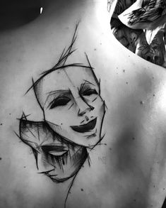 A beautiful tattoo design in sketch style. Sad and happy masks inked on the girl's back. Style: Sketch. Color: Black. Tags: Beautiful