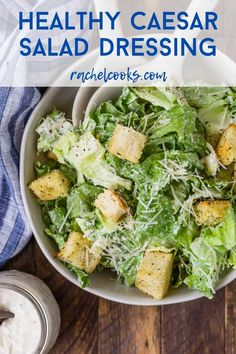 Prepare a classic Caesar salad easily with your own healthy Caesar dressing. Lower in calories than traditional Caesar dressings, you'll love how great this homemade salad dressing tastes. Salads For A Crowd, Main Dish Salads, Salad Recipes For Dinner, Easy Salads, Healthy Salad Recipes, Lunch Recipes, Healthy Foods, Healthy Caesar Dressing Recipe, Healthy Caesar Salad
