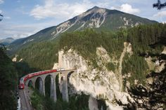 Added to the list of World Heritage Sights in 2008, the Rhaetian Railway brings together two historic railway lines that cross the Swiss Alps. Photo by Ikiwaner on Wikimedia Commons