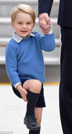 Prince George was wearing a blue jumper with blue shorts and knee-length socks but this time with 'big boy' lace up shoes