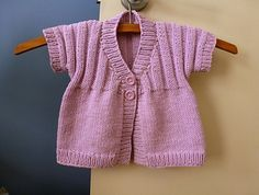 Short sleeved cardigan knitted in 3 pieces only - back and two fronts.
