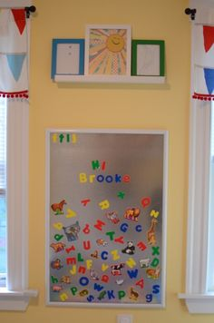 Magnetic board!   Use my clean drip pan and letters I already have! (and lots of other playroom ideas here)