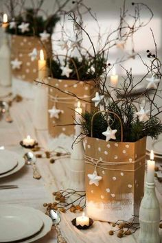 Gift Bag Galore: Switch up Christmas grab bags for something a bit more glam. Brush brown paper gift bags with white paint, creating a snowy scene. Stuff with pine and branches before finishing with a wrap of charm-adorned twine. Neutral, minimal, beautiful. Click through for more DIY Christmas centerpieces you'll love!