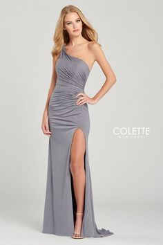 Colette for Mon Cheri CL12044. One shoulder shimmer stretch sheath gown with ruching at the natural waist, strappy open back, and a high thigh slit.