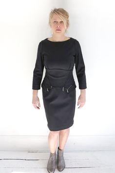 Oblique flattering slim fitting dress with a corset waist flattering belt at ATELIER957