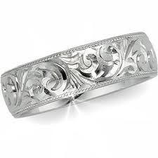 Google Image Result for http://www.jewelleryweddingbands.com/wp-content/uploads/Unique-Wedding-Rings-For-Women-And-Men.jpg