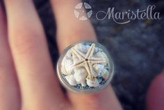 UNIQUE glass ring. REAL mini seashells, REAL starfish! Terrarium Ring. Creative Gift. Wear the beach with you all time. Summer in a ring. by Maristella890 on Etsy https://www.etsy.com/listing/208471495/unique-glass-ring-real-mini-seashells