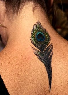 My mom and I have always been obsessed with peacock feathers. Id get this for her. I love how detailed it is, not so cartoon-y like other feather tattoos. bennibelle