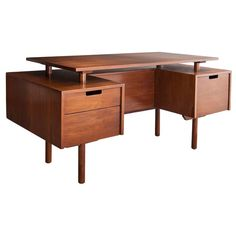 Desk in walnut by Milo Baughman | From a unique collection of antique and modern desks at https://www.1stdibs.com/furniture/storage-case-pieces/desks/