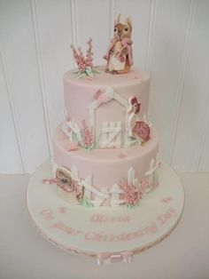Two tier Flopsy Bunny cake - Beatrix Potter with handpainted plaques Peter Rabbit Cake, Peter Rabbit Birthday, Peter Rabbit Party, Bunny Birthday Cake, First Birthday Cakes, Smash Cake Girl, Girl Cakes, Beatrix Potter Birthday Party, Beatrix Potter Cake