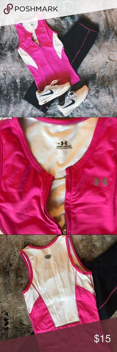 Under Armour pink workout top Sporty pink sleeveless workout top from Under Armour with built in sports bra. White panels on the sides give it a shapely look while you can zip or unzip the top as much as you'd like to reveal the built in bra. Back of top has a small hidden pocket for keys. I have this exact top in teal blue in my closet as well (shown in final photo) so be sure to check it out as well if you love this one! Under Armour Tops Tank Tops