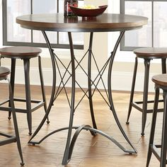 @Overstock.com - Counter Height Pub Table - This beautiful tall pub table features a 36 inch round top finished in a hand rubbed warm chestnut.  The sturdy metal base features a crisscross design, which can add beauty and style to any kitchen or dining room.  http://www.overstock.com/Home-Garden/Counter-Height-Pub-Table/8500220/product.html?CID=214117 $157.99