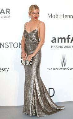 The actress wows in a slinky gunmetal Ralph Lauren gown, which she pairs with a monochrome clutch, swept-back locks and crimson pout.