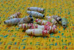 Recycle old maps and atlases.   Art with Kids: Paper Map Beads