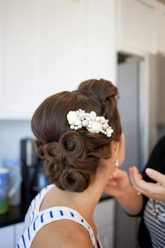 Vintage wedding hairstyles work as well today as they did decades ago. Check out these elegant brides who are sure to inspire you with your Big Day 'do.