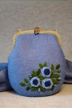 Bag is made in the technique of wet felting of wool with the addition of decorative viscose fibers . Handcrafted embroidery . Brass purse frame with kiss lock clasps. Chain can be removed easily. Its exclusive item without replication. SIZE in cm: bottom width - 6 top width - 25