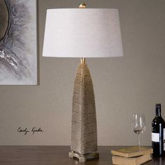 The Kolva Silver Beaded Lamp's heavily beaded texture is finished in an antiqued silver leaf with a dark gray wash. Works well with modern, Rough Luxe and a variety of interior design styles.
