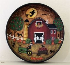This item is ready to ship. This wooden bowl features my original Halloween hand painted folk art design. A witch on a tractor is pulling a cart of freshly picked apples in front of a primitive style red barn. Her sister is riding a broom in the light of a full moon while several little ghosts and a pumpkinhead hide in the barn. Black cats and crows linger in the barnyard. The bowl is sealed with matte finish and measures about 5 3/4 inches in diameter and 1 3/4 inches high. The back of t...