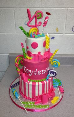Candy Themed Cake:  buttercream iced with handmade fondant candies and lolliies by Jeanine at It Takes The Cake near Atlanta