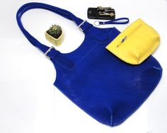 Blue bag made of genuine leather. Can be worn on the shoulder. Bright color is driving you crazy! Thick leather, beautiful structure, stylish minimalist design. You'll wear it every day! Hand made.
