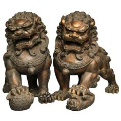 A Large Pair Of Gilt-lacquered Bronze Figures Of Foo Lions,19th Century | From a unique collection of antique and modern sculptures and carvings at http://www.1stdibs.com/furniture/asian-art-furniture/sculptures-carvings/