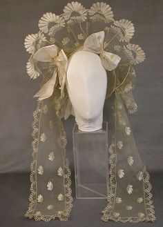 Wedding Bonnet c. White silk net and blond lace wedding bonnet. From Hampshire County Council Arts and Museum Services collection. Historical Costume, Historical Clothing, Vintage Bridal, Vintage Lace, Look Gatsby, Victorian Fashion, Vintage Fashion, 19th Century Fashion, Antique Clothing