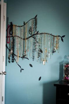 Painted Wall Branches + Silver Thumbtacks = Great Idea for Necklace Storage Or...use removable shelf liner paper in black  instead of paint?  Spray paint hooks black so they disappear.