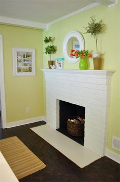 I've really been trying to get my husband to let me paint the fireplace. Ours is exactly the same, but not white.