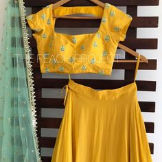 The Yellow Cabo Lehenga Set For the simple haldi bride or a serial wedding attendee this mango yellow lehenga set is all about taking the sunshine everywhere with you! Half Saree Lehenga, Sari, Anarkali, Dress Neck Designs, Blouse Designs, Sangeet Outfit, Yellow Lehenga, How To Dress For A Wedding, Lehenga Wedding