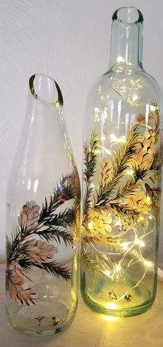 Wine bottles cut at a slant and filled with wire lights #recycledwinebottles