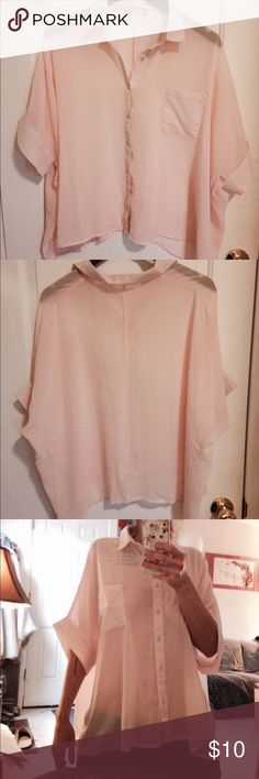 Sheer light pink blouse. Very pretty pink blouse. It's pretty sheer (as you can see), light and flowy! I cut the tags out because they were itchy, but I only wore it once or twice and it's in great condition otherwise. ROMWE Tops Blouses