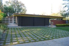 Very Cool Driveway Idea: Broken Up with Grass