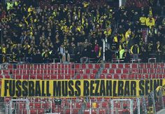 Dortmund fans stage tennis ball protest over ticket prices