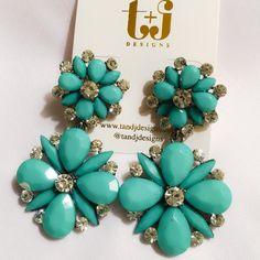 T & J Designs Aqua/Green Floral Drop Earrings Beautiful Aqua/green floral drop earrings with crystal accents. What a striking statement they will make with your white or black Spring/Summer outfit. Material content: Resin, base metals, glass crystals. Price is firm unless bundled. T&J Designs Jewelry Earrings