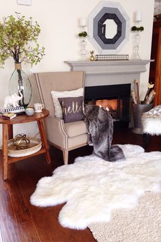 This beautiful chair from HomeGoods is the perfect spot to sit and enjoy the warmth of the fireplace. The furry stool that's also from HomeGoods is ready to be pulled over and put your feet up on. To complete this comfy scene add a cup of coffee, tea, or better still hot chocolate! Sponsored by HomeGoods