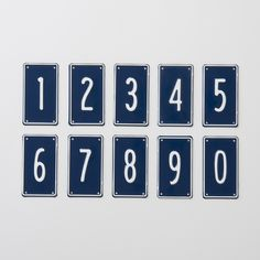 Exclusive to Schoolhouse, these embossed aluminum signs are made with antique tooling by a 100-year-old, third-generation, family-run Portland company. Powder coated with white numbers and border on navy blue field.