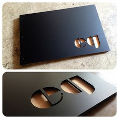 Custom graphic designer portfolio book with cut-out treatment on matte black acrylic | da KloPortfolios.com