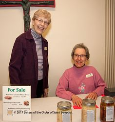 """""""Nun Banquet"""" in support of Habitat for Humanity, March 17, 2017. Details at www.sbm.osb.org. Photo by Karen Streveler, OSB, shows Sisters Pat Ruether and Lucinda Mareck selling soup at the event in 2015."""