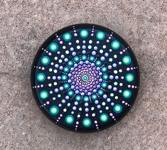 """Beatiful round stone 3"""" inches in diameter painted with pink, green and purple original mandala dot art design. The design is hand painted using high quality acrylic paints then sealed multiple times with a premium high gloss finish."""