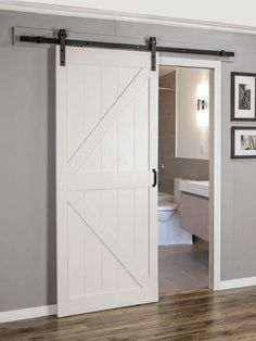 Paneled Manufactured Wood Finish Continental Barn Door with Installation Hardware Kit Continental MDF Engineered Wood 1 Paneel Scheunentor Houses Architecture, Classical Architecture, Indoor Barn Doors, Barn Door Designs, Sliding Barn Door Hardware, Door Hinges, Install Barn Door, Sliding Barn Door For Closet, Sliding Room Doors