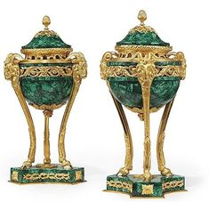 A PAIR OF GILT-BRONZE BRULE PARFUMES <br />OF LOUIS XVI STYLE, EARLY 20TH CENTURY, LATER MALACHITE VENEERED <br />The censors with triform ram's head monopodiae <br />16 in. (40.6 cm.) high (2)<br />