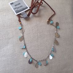 Turquoise Rope Necklace A beautiful rope necklace (adjustable in length based on how you tie ) with a silver chain that has turquoise and silver charms dangling. BRAND New. Listing is for one, but I have two. Perfect for the Coachella / festival season! Anthropologie Jewelry Necklaces
